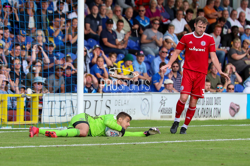 Accrington Stanley goalkeeper Dimitar Evtimov (1) saving from AFC Wimbledon midfielder Mitchell (Mitch) Pinnock (11) during the EFL Sky Bet League 1 match between AFC Wimbledon and Accrington Stanley at the Cherry Red Records Stadium, Kingston, England on 17 August 2019.