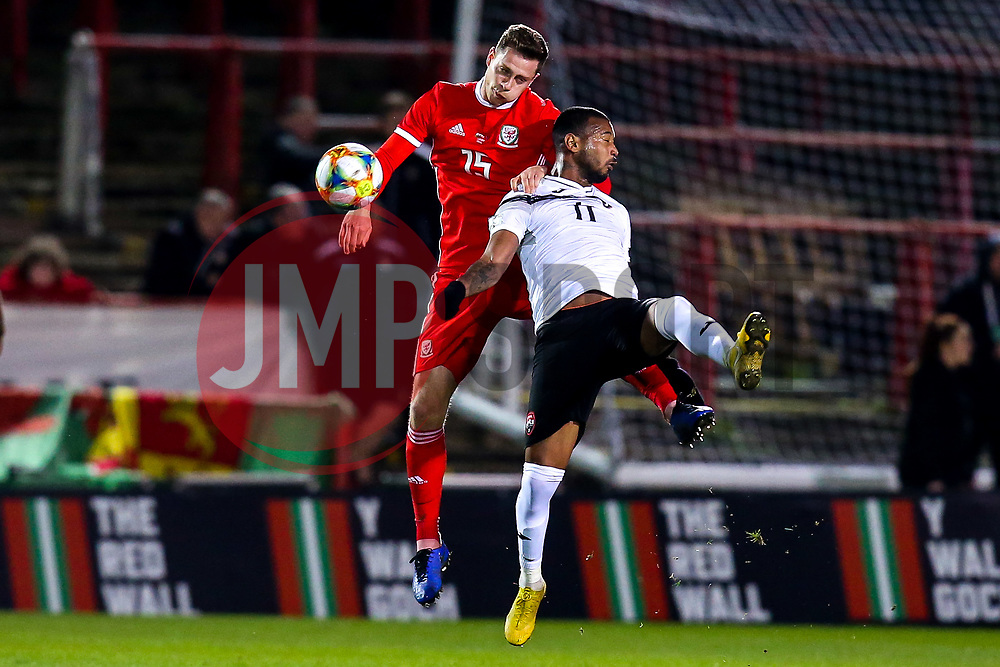 Ryan Hedges of Wales challenges Lester Peltier of Trinidad and Tobago to a header - Mandatory by-line: Robbie Stephenson/JMP - 20/03/2019 - FOOTBALL - The Racecourse Ground - Wrexham, United Kingdom - Wales v Trinidad and Tobago - International Challenge Match