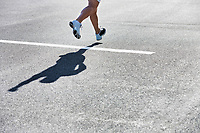 Man running on white starting line