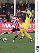 Kyle Storer and Ben Chorley during the Vanarama National League match between Cheltenham Town and Bromley at Whaddon Road, Cheltenham, England on 30 January 2016. Photo by Antony Thompson.