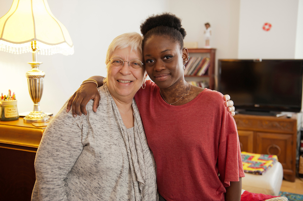 "Michaela DePrince at her home in Manhattan. ..vrnl: Adoptivmutter Elaine DePrince und Michaela DePrince...Michaela DePrince was born in war-torn Sierra Leone on January 6, 1995 where she was named Named Mabinty Bangura. Her adoptive parents were told that her father was shot by rebels when she was three years old, and that her mother starved to death soon after. Frequently malnourished, mistreated, and derided as a ""devil's child"" because of vitiligo, a skin condition causing depigmentation, she fled to a refugee camp after her orphanage was bombed. In 1999, at age four, she and another girl, Mia, were adopted by Elaine and Charles DePrince from New Jersey, and taken to the United States. (source: Wikipedia)..Photo © Stefan Falke.www.stefanfalke.com"