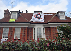©London News pictures. 09/03/11. Squatters on the roof of a house belonging to the Gaddaffi family in Hampstead today. Picture Credit should read Stephen Simpson/LNP