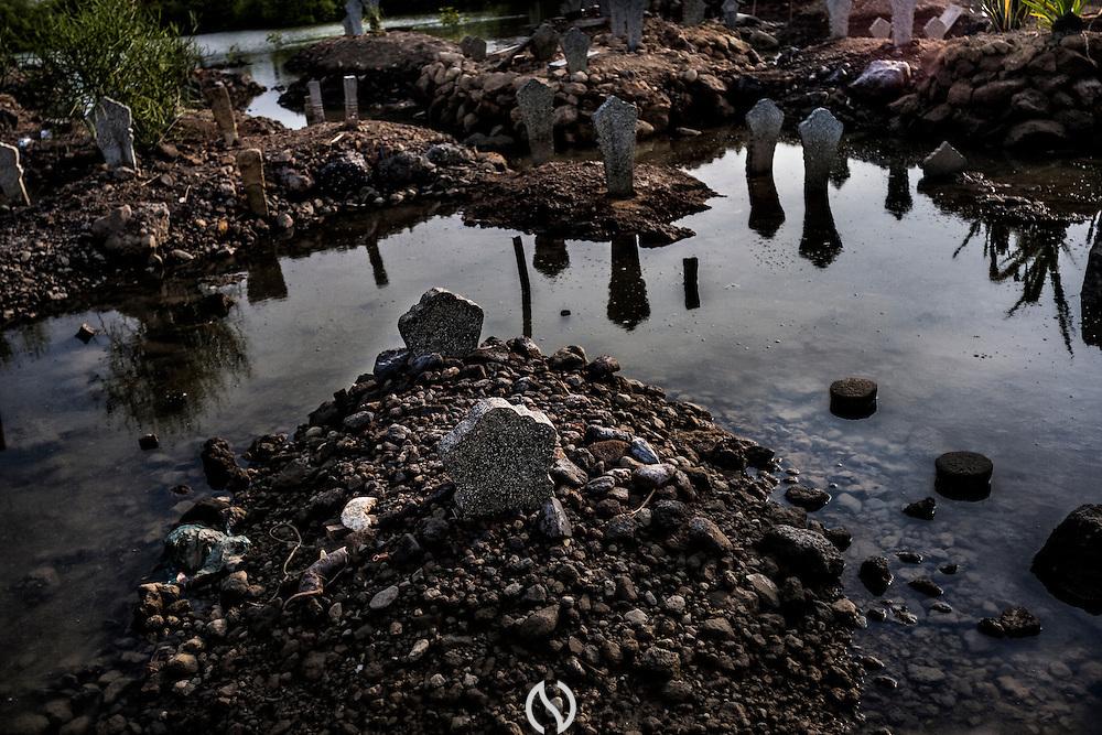 A flooded grave yard in Bedono village, near Semarang.