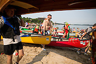 The 35th Annual Paddle & Portage was held Saturday, July 19, 2014, starting at James Madison Park in Madison, Wisconsin. There is a 1.5 mile loop in Lake Mendota, a portage up North Hamilton Street and around part of the Capitol Square, then into Lake Monona where they finish at Olin Park.