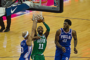 Boston Celtics Kyrie Irving (11) lines up to shoot during the NBA London Game match between Philadelphia 76ers and Boston Celtics at the O2 Arena, London, United Kingdom on 11 January 2018. Photo by Martin Cole.