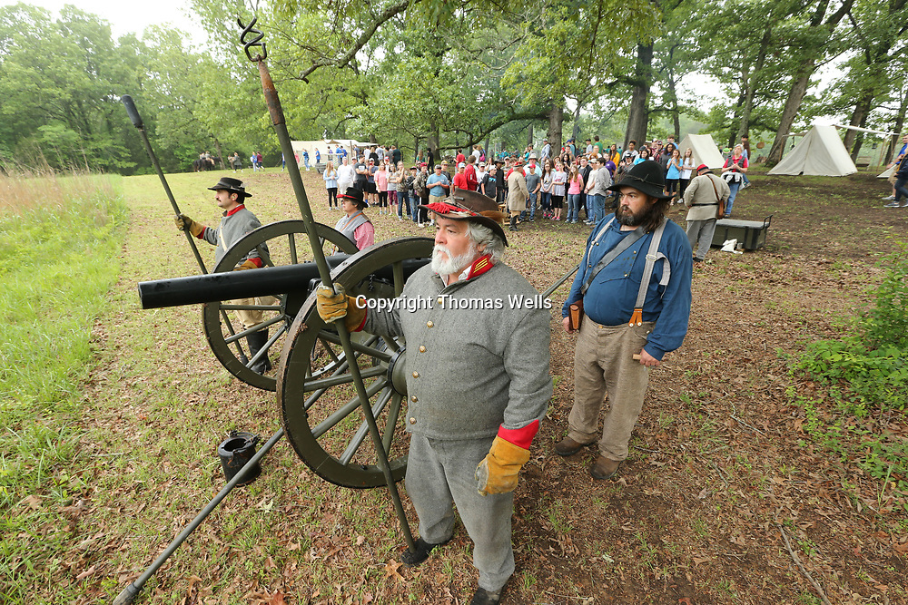 Archie Millign, center, of Tuscaloosa Alabama and James Gray, right, join stand ready before they demonstrate how a civil war cannon was fired during the war during Friday's Brice's Crossroads Discovery School Day.