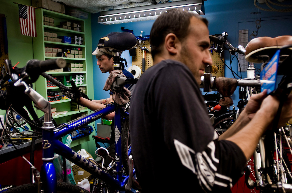 The repair shop at The Macdonalds Cycle Center in Millenium Park - a station, where commuters can park their bikes and shower before going to the office.<br /> <br /> Mechanic Lew Chin (left) and manager Dan Ioja (right) fixing bikes for the members of the station. <br /> <br /> Photographer: Chris Maluszynski /MOMENT