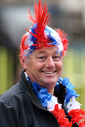 © Licensed to London News Pictures. 28/09/2016. Leeds, UK. A man wearing a union jack mohican wig smiles  during the Olympic and Paralympic parade in Leeds. Yorkshire's Olympic and Paralympic stars receive a heroes' welcome during an open top bus parade in Leeds, West Yorkshire.  Photo credit : Ian Hinchliffe/LNP