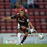 Tom Taiwo of Carlisle United and Bristol City's Marvin Elliott<br /> Bristol City vs Carlisle<br /> Carling Cup Round 2, Ashton Gate, Bristol, UK<br /> 26/08/2009. Credit Colorsport/Dan Rowley<br /> Football