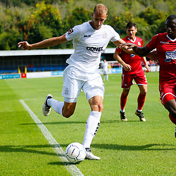 Dovers defender Tim Schmoll crosses the ball during the opening National League match between Dover Athletic and Wrexham FC at Crabble Stadium, Kent on 04 August 2018. Photo by Matt Bristow.