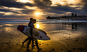 Surfers On The Beach At Oceanside Pier During Sunset