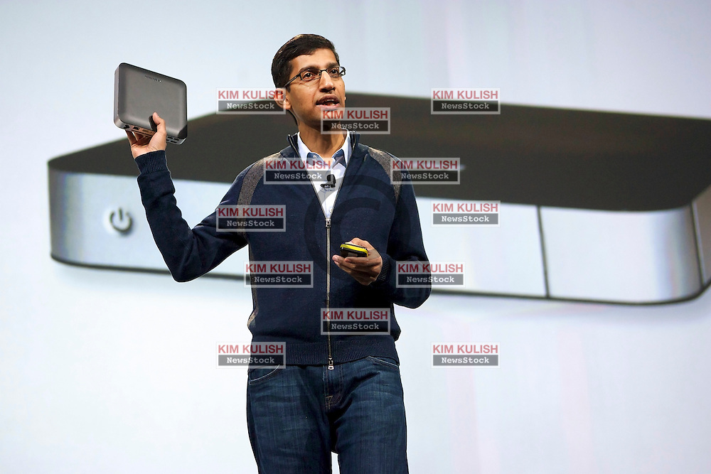Sundar Pichai, senior vice president of Chrome at Google Inc., holds up a Chrome desktop computer manufactured by Samsung Electronics Co. ,during his keynote address at the Google I/O  developer's conference in San Francisco, California.