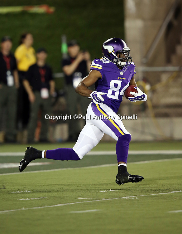 Minnesota Vikings kick returner Cordarrelle Patterson (84) returns a second quarter kickoff during the 2015 NFL Pro Football Hall of Fame preseason football game against the Pittsburgh Steelers on Sunday, Aug. 9, 2015 in Canton, Ohio. The Vikings won the game 14-3. (©Paul Anthony Spinelli)