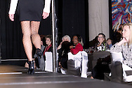 The audience watches a  model on the runway during the 23rd Annual Bravo! Fashion Show at the Sinclair Conference Center in downtown Dayton, Friday, October 1, 2010.