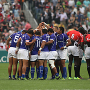 Manu Samoa gathers for its first game against Kenya.  Photo by Barry Markowitz 3/23/12