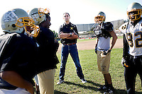"""George Visger, 51, of Grass Valley, Ca., watches practice at his former high school, Staggs High, in Stockton, Ca., on Friday, Oct. 9, 2009. Visger has severe short-term memory loss due to multiple head injuries, however retains a better long-term memory. Visger says there are years that really don't exist. """"I don't really remember them happening."""" Visger survived 9 brain surgeries, caused by concussions incurred throughout his playing career. His first one in 1981, when he turned 23 years old. He keeps daily notes in a yellow notebook and has about three boxes full of notebooks that date back to 1990. ..He works with the Coaches Concussion Clinic, the Brain Injury Association and the Hydrocephaleus Association to increase awareness of concussion-related injuries. ..Visger was a scholarship player for the University of Colorado Buffalos on the 1977 Orange Bowl team, and a 1980 6th round draft pick who played for the San Francisco 49ers, earning a Super Bowl ring for the 1981 Super Bowl Championship."""