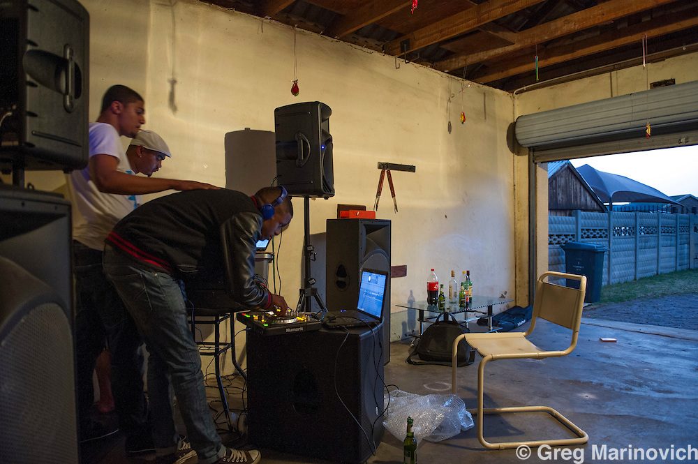 Roodepoort, 22 September 2012, DJ Lutz (real name Lutz Salvador) and DJ Vato_loco (real name Eldean Brooks in white cap) and DJ Stevo Jams (real name Stevens Jacobs in white shirt) make music in a garage in a lower middle class suburban home. Photo Greg Marinovich