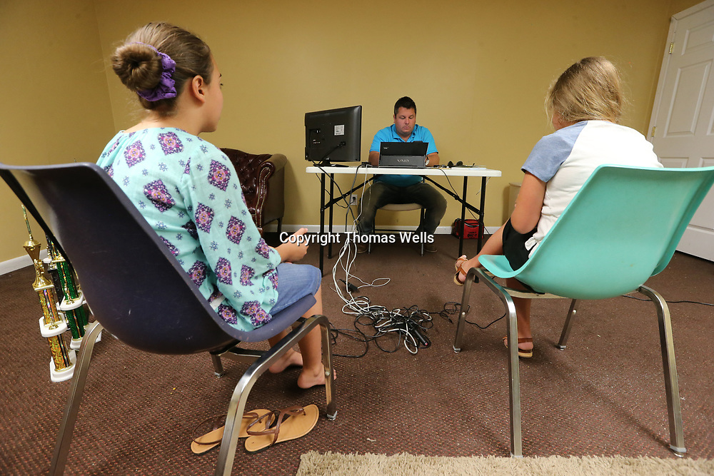 Damon Fisher, center, quizs Maddie Erickson, left, and Anistyn Fisher for their practice as they prepare for a national bible quiz competetion.