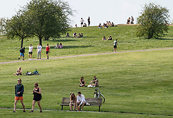 © Licensed to London News Pictures. 11/04/2020. London, UK. People sunbathing and exercising on Primrose Hill, London over Easter Bank holiday weekend, during a pandemic outbreak of the Coronavirus COVID-19 disease. The public have been told they can only leave their homes when absolutely essential, in an attempt to fight the spread of coronavirus COVID-19 disease. Photo credit: Ben Cawthra/LNP