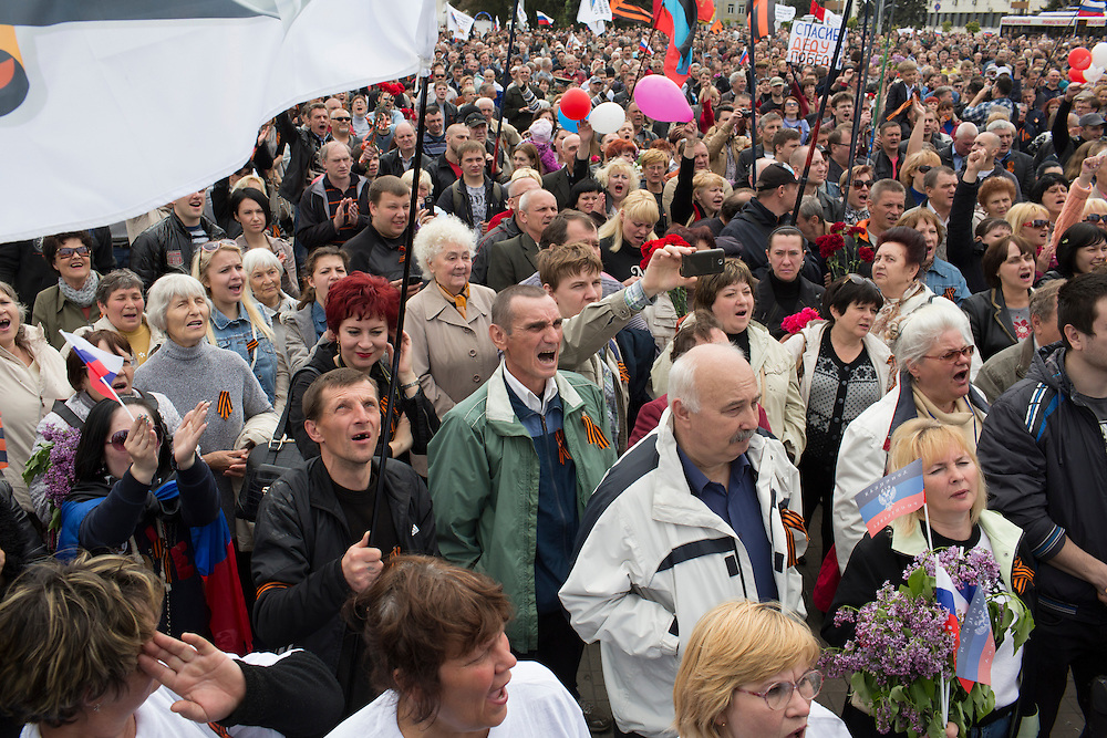 DONETSK, UKRAINE - MAY 9: A crowd of people cheer at a pro-Russia demonstration on May 9, 2014 in Donetsk, Ukraine. Tensions in Eastern Ukraine are high after pro-Russian activists seized control of at least ten cities and ahead of the Victory Day holiday and a planned referendum on greater autonomy for the region. (Photo by Brendan Hoffman/Getty Images) *** Local Caption ***