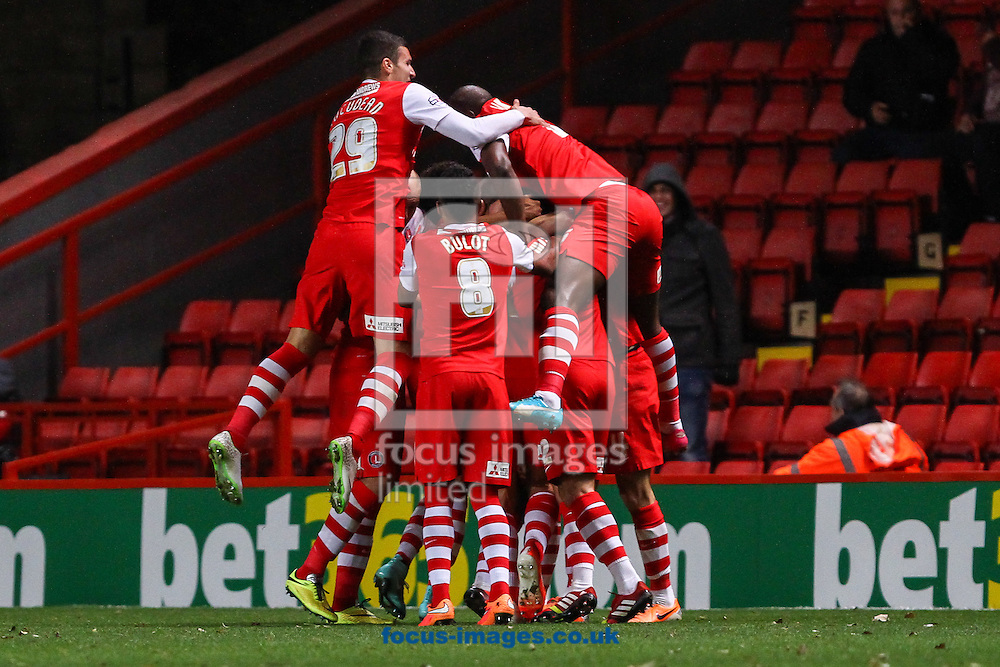 Johnnie Jackson of Charlton Athletic (middle) celebrates scoring his team's second goal against Bolton Wanderers to make it 2-0 with team mates during the Sky Bet Championship match at The Valley, London<br /> Picture by David Horn/Focus Images Ltd +44 7545 970036<br /> 21/10/2014