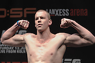 "COLOGNE, GERMANY, JUNE 12, 2009: Stefan Struve poses on the scales at the official weigh-in for ""UFC 99: The Comeback"" inside LanXess Arena in Cologne, Germany on June 12, 2009"