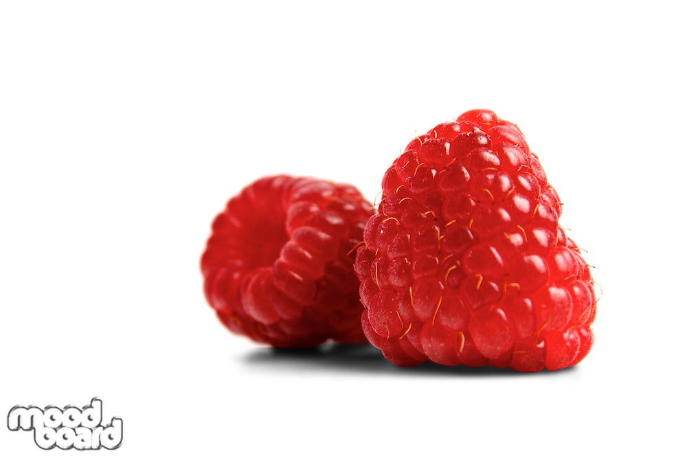 Red raspberries on white backgroud