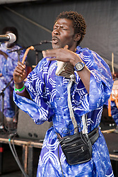 Senegalese Modou Diouf and O Fogum on stage at the WOMAD (World of Music; Arts and Dance) Festival in reading; 2005,
