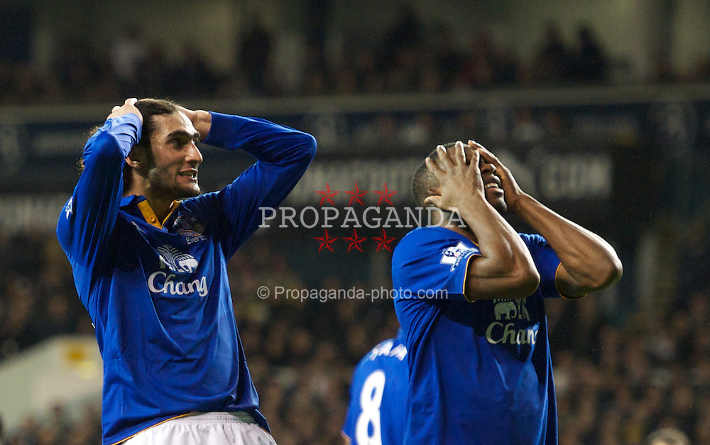 LONDON, ENGLAND - Wednesday, January 11, 2012: Everton's Marouane Fellaini and Victor Anichebe react during the Premiership match at White Hart Lane. (Pic by Chris Brunskill/Propaganda)