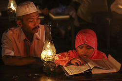 June 11, 2017 - Solo, Central Java, Indonesia - SOLO, INDONESIA - JUNE 12 : Students Islamic boarding school Baitul Mustafa read Quran by lighting oil lamps or called semprong at Mojosongo village on June 11, 2016 in Solo city, Central Java, Indonesia. This activity in the framework of Revelation of the Qur'an and closer to nature and educate students in order diligently reading the Quran, especially during Ramadan..Photo by Vian Saputra/Sijori Images (Credit Image: © Sijori Images via ZUMA Wire)