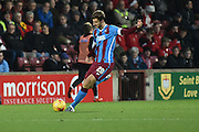 Charlie Goode of Scunthorpe United kicks forward  during the Sky Bet League 1 match between Scunthorpe United and Sheffield Utd at Glanford Park, Scunthorpe, England on 19 December 2015. Photo by Ian Lyall.