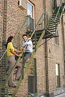 Young Couple on Fire Escape