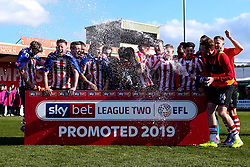 Lincoln City celebrate winning promotion from Sky Bet League Two to Sky Bet League One - Mandatory by-line: Robbie Stephenson/JMP - 13/04/2019 - FOOTBALL - Sincil Bank Stadium - Lincoln, England - Lincoln City v Cheltenham Town - Sky Bet League Two