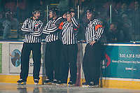 KELOWNA, CANADA - NOVEMBER 9:  Mike Langin and Alex Teichroeb, linesmen and Mark Pearce and Brett Montsion, referees stand on the ice at the start of the game of the Red Deer Rebels at the Kelowna Rockets on November 9, 2012 at Prospera Place in Kelowna, British Columbia, Canada (Photo by Marissa Baecker/Shoot the Breeze) *** Local Caption ***