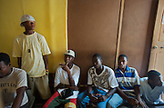 Members of Feu Hip Hop, an aspiring rap group, work on tracks at the Rap Forum studio in the Salomon neighborhood in Port-au-Prince, Haiti on July 17, 2008. Numerous young groups, largely comprised of young men, have come out of the woodwork lately to try to make it as artists, inspired by the recent tragedy that befell one of the country's most prominent groups, Barikad Crew. The band lost three of its 11 members to a tragic automobile accident in June.