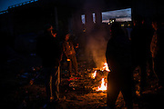 Migrants burning wood and old plastic tents in the Calais, camp, France. FEDERICO SCOPPA/CAPTA