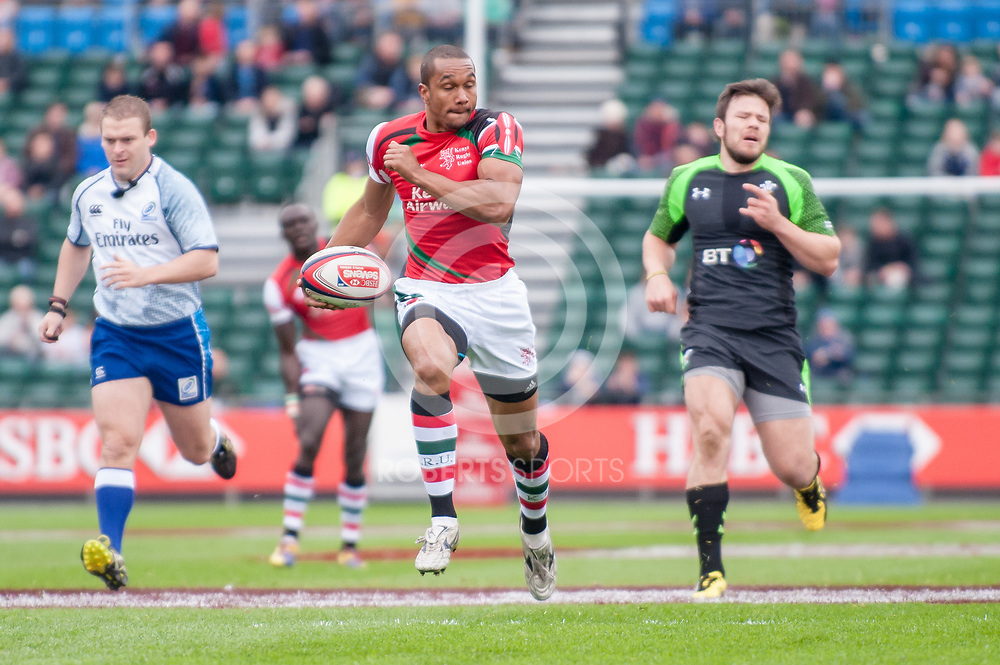 Kenya's Biko Adema sprints away from the Welsh defenders to score a try during their Pool C match. Action from the IRB Emirates Airline Glasgow 7s at Scotstoun in Glasgow. 3 May 2014. (c) Paul J Roberts / Sportpix.org.uk