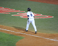 Ole Miss' Austin Anderson watches his game winning three run home run in the 13th inning vs. Auburn at Oxford-University Stadium in Oxford, Miss. on Friday, April 4, 2014. Mississippi won 8-5.