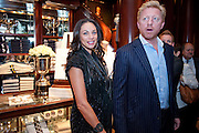 Sharlely Becker; Boris Becker, The 2010 Ralph Lauren Wimbledon Party hosted by Elizabeth Saltzman in support of Too Many Women in celebration of the renewal of the Ralph Lauren Wimbledon partnership. Ralph Lauren shop. No.1 New Bond Street, London W1. 20 June 2010. <br />  <br /> -DO NOT ARCHIVE-© Copyright Photograph by Dafydd Jones. 248 Clapham Rd. London SW9 0PZ. Tel 0207 820 0771. www.dafjones.com.