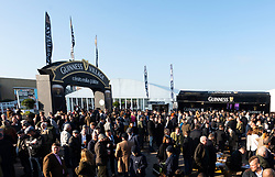 Racegoers watch the Syndicate Horse Parade at Cheltenham Racecourse