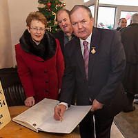 An tUachtaran Cumann Luthchleas Gael, Mr. Liam O'Neill, with his wife Áine and Michael Talty, Chairman of the Kilmurry Ibreckane Centenary Committee, signs the guest book, during their visit to the Kilmurry Ibrickane GAA Club Centenary Closing Ceremony