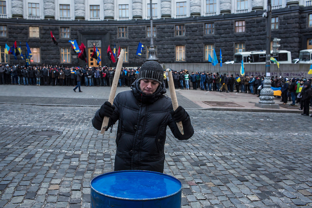 KIEV, UKRAINE - DECEMBER 5: An anti-government protester beats a drum at a rally in front of the Cabinet of Ministers building on December 5, 2013 in Kiev, Ukraine. Thousands of people have been protesting against the government since a decision by Ukrainian president Viktor Yanukovych to suspend a trade and partnership agreement with the European Union in favor of incentives from Russia. (Photo by Brendan Hoffman/Getty Images) *** Local Caption ***