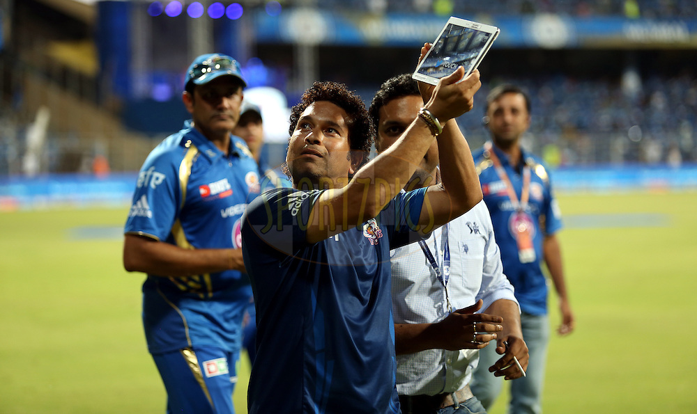 Sachin Tendulkar Of the Mumbai Indians Takes a lap of the ground after the match 22 of the Pepsi Indian Premier League Season 2014 between the Mumbai Indians and the Kings XI Punjab held at the Wankhede Cricket Stadium, Mumbai, India on the 3rd May  2014<br /> <br /> Photo by Sandeep Shetty / IPL / SPORTZPICS<br /> <br /> <br /> <br /> Image use subject to terms and conditions which can be found here:  http://sportzpics.photoshelter.com/gallery/Pepsi-IPL-Image-terms-and-conditions/G00004VW1IVJ.gB0/C0000TScjhBM6ikg