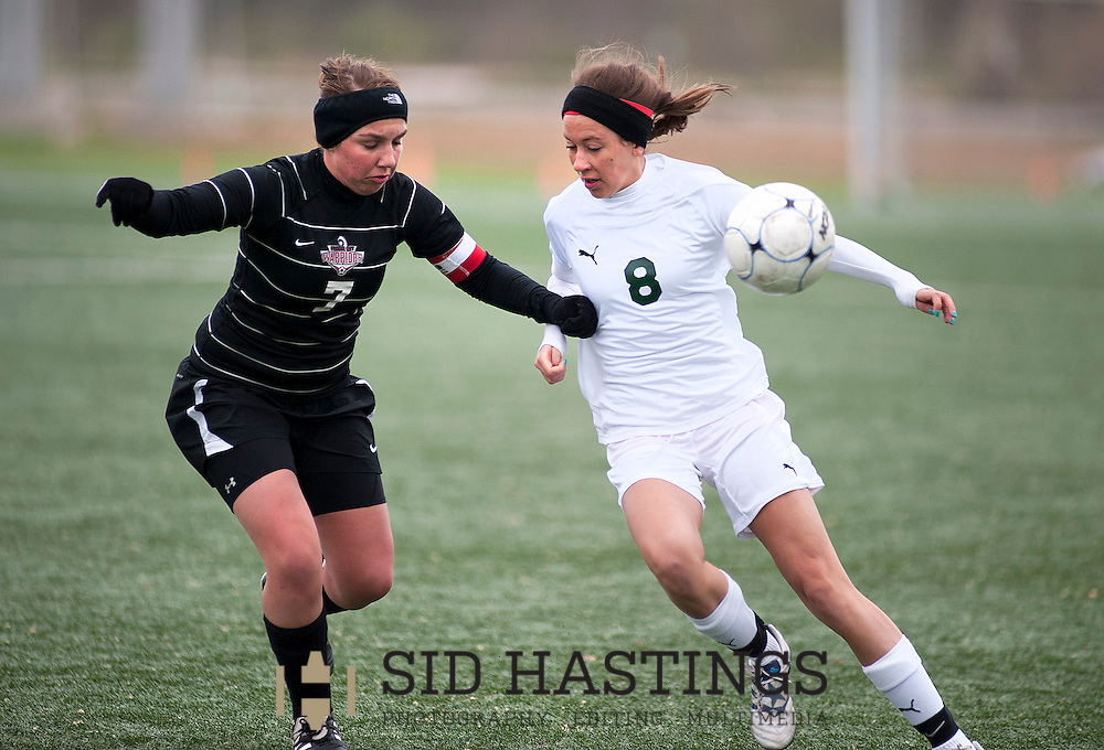 Nerinx Hall High School soccer player Hailey VanDerleest (8) battles Granite City High School's Kelsie Nesbit (7) for control of the ball during the STL Soccer Classic 2013 opening round Friday, April 12, 2013 at Lou Fusz Soccer Club in Maryland Heights. Photo © copyright 2013 Sid Hastings.