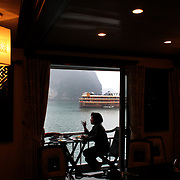 Early morning breakfast on board a tourist Junks in Ha Long Bay, Vietnam. The bay consists of a dense cluster of 1,969 limestone monolithic islands. Ha Long Bay, is a UNESCO World Heritage Site, and a popular tourist destination. Ha Long, Bay, Vietnam. 11th March 2012. Photo Tim Clayton