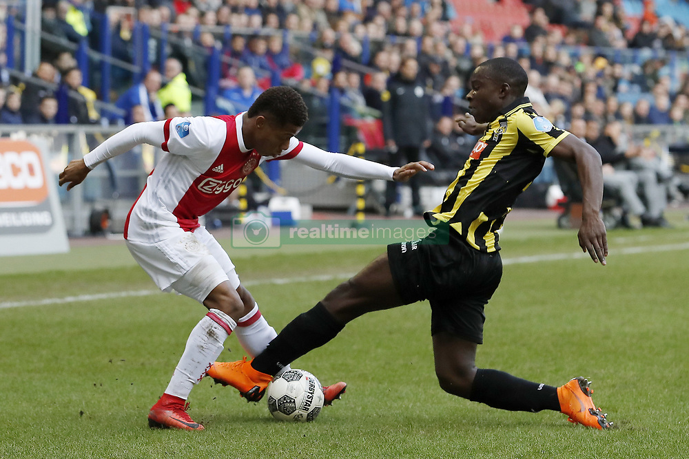 (L-R) David Neres of Ajax, Lassana Faye of Vitesse during the Dutch Eredivisie match between Vitesse Arnhem and Ajax Amsterdam at Gelredome on March 04, 2018 in Arnhem, The Netherlands