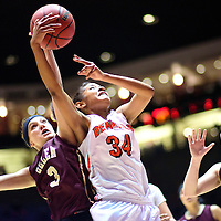 031015  Adron Gardner/Independent<br /> <br /> Belen Eagle Danielle Saavadra (3), left, competes for a  rebound with Gallup Bengal Ni'asia McIntosh (34) during the New Mexico state basketball tournament at The Pit in Albuquerque Tuesday.  The Bengals beat the Eagles in the 5A quarterfinal 76-33.