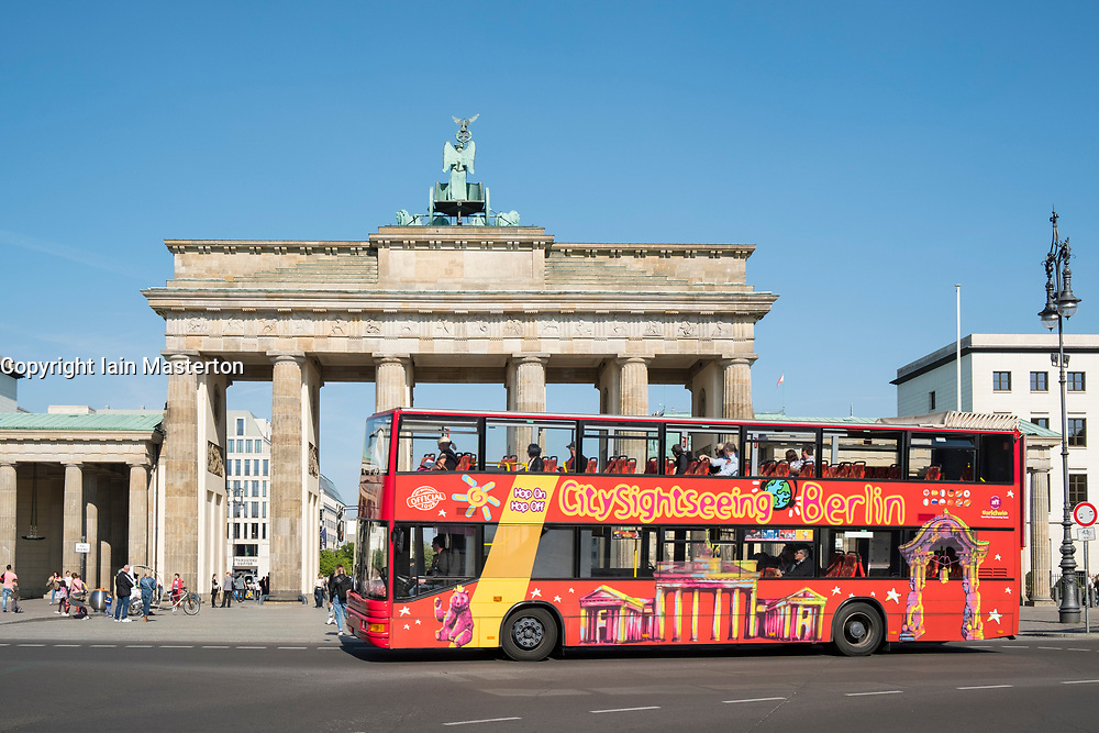 Tourist tour bus in front of Brandenburg Gate in Berlin, Germany