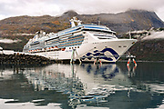 A cruise ship docked at the Whittier marina and ship terminal on the Passage Canal in Prince William Sound, Whittier, Alaska.