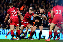 Ollie Devoto of Exeter Chiefs is tackled by Nick Isiekwe of Saracens - Mandatory by-line: Ryan Hiscott/JMP - 29/12/2019 - RUGBY - Sandy Park - Exeter, England - Exeter Chiefs v Saracens - Gallagher Premiership Rugby